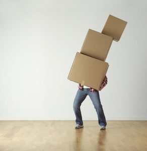 A man carrying three packingboxes