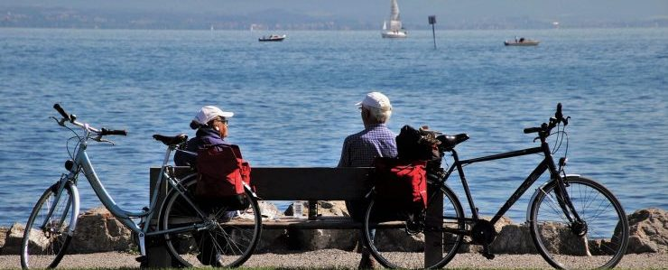 two people sitting on a bench, representing senior movers fl