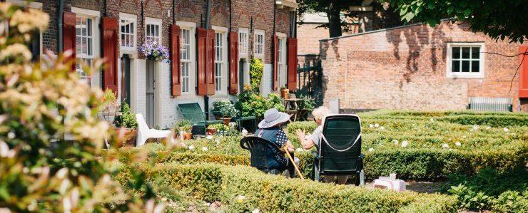 two elderly women sitting outside