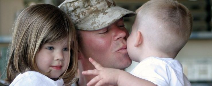 A military man holding his kids, representing military movers FL