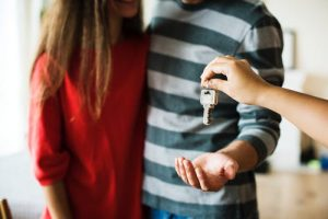 a couple getting the keys to their new home