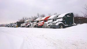 Trucks in a snowy parking lot
