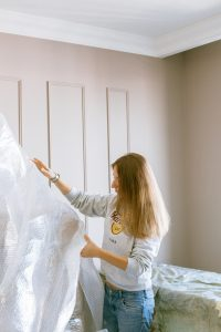 woman holding a plastic