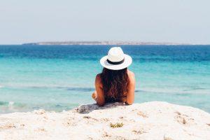 woman lying on white sand beach