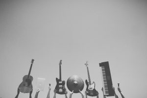 Guitar, bass, drum kit and other musical instruments