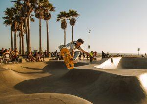 man on a skateboard in a park