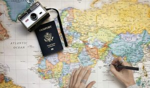 a camera and a passport on a map