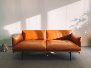 2 seat orange leather sofa