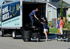 people loading a moving truck