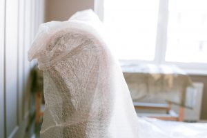 furniture wrapped in bubble wrap