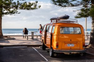 yellow van parked next to the beach