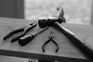 Tools for disassembling furniture on a desk