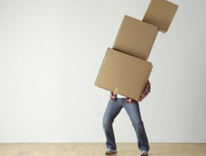 a man carying moving boxes