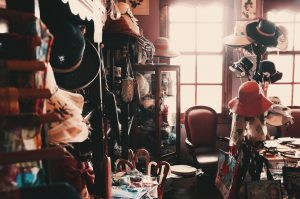 A messy room with many pieces of old clothes