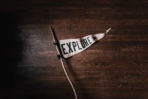 white flag with the word explore on it