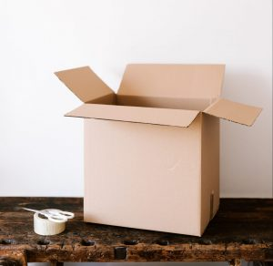 Moving box, scissors and duct tape.