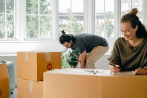 a person packing and moving with help
