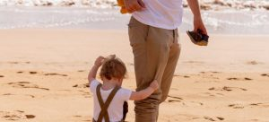 -a man with his child on the beach