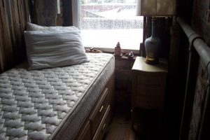 A white mattress which needs to be removed in order to peropely pack and move bunk beds