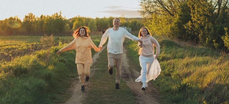 joyful-friends-running-on-path-in-countryside
