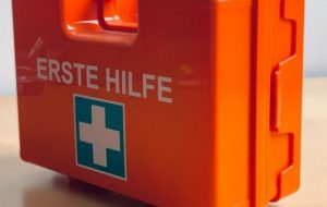 An orange first aid kit