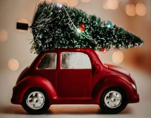 A red card driving a Christmas tree