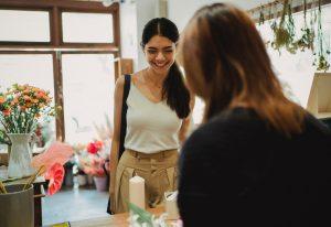 two women talking, smiling