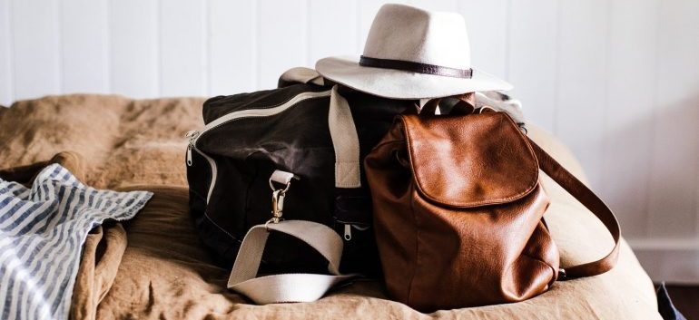 Packing the bag of essentials for your interstate relocation in a few different bags