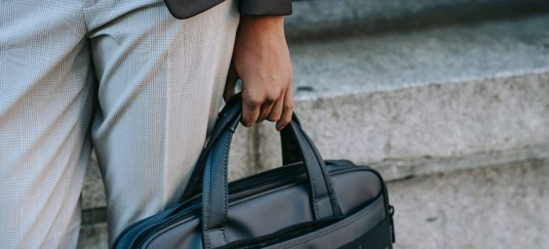 Woman carrying the essentials bag