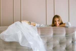 A woman protecting her furniture with bubble wrap