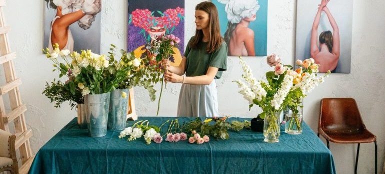 Woman arranging flowers to update her Florida residence