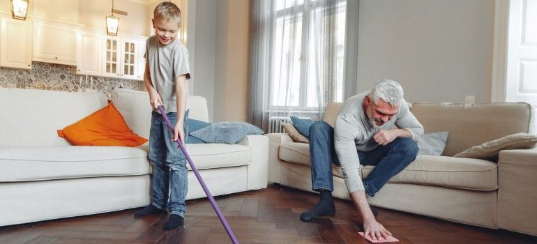 A father and son cleaning.