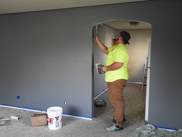a man painting a wall - quick repairs that can add value to your Clearwater home