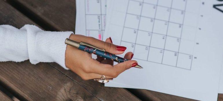 person marking a calendar