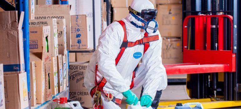 Man in a protective suit with hazardous materials