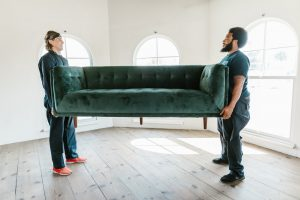 Movers moving a sofa