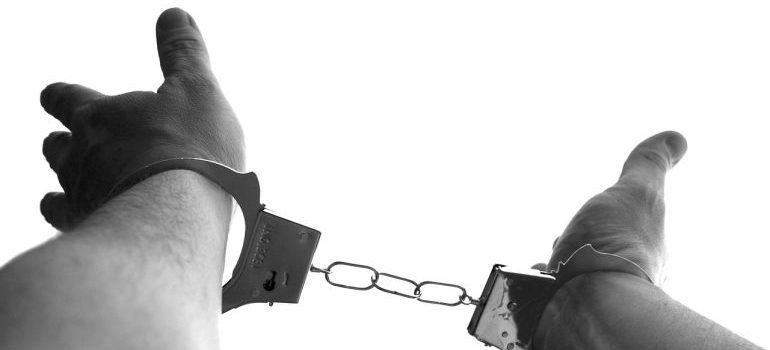 a man in handcuffs - decide between Gulfport and Dunedin